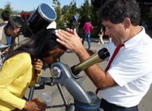 Gary Weston, associate professor of physics, adjusts telescope for interested student. (Photo: Barry Zepel)