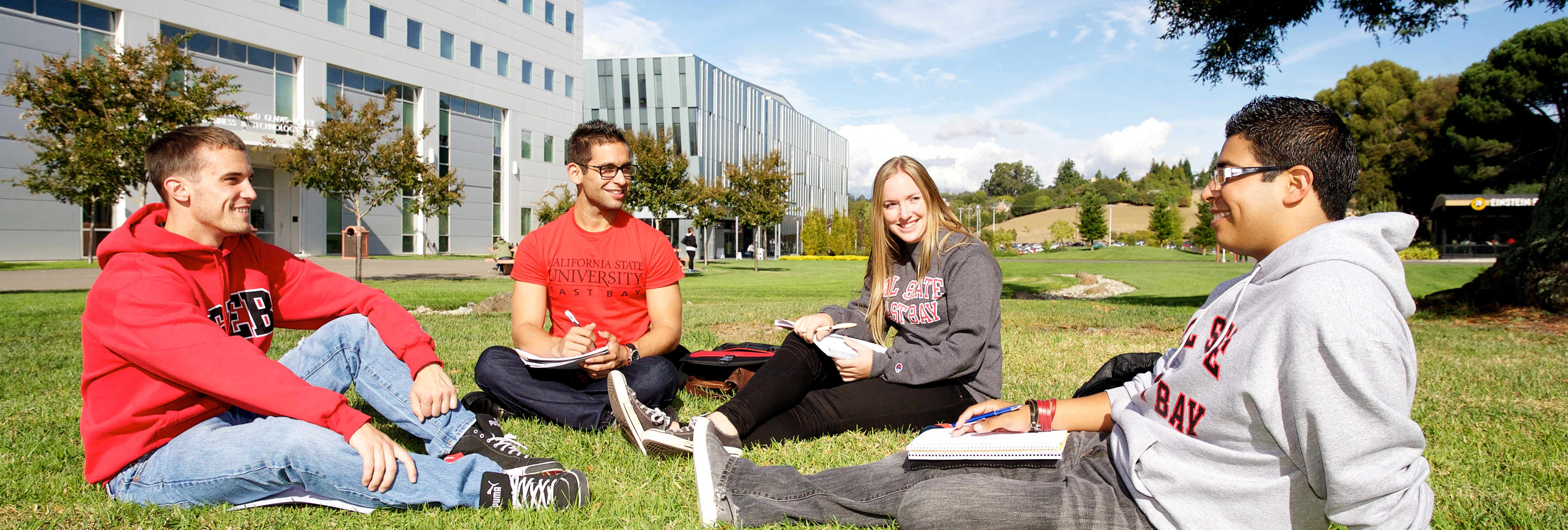 Students talking on lawn in front of Valley Business Technology Center